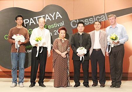 (Left to right): Tomonori Arai, Leon Koudelak, Kamala Sukosol, president of Siam Hotels & Resorts, Monching Carpio, Father Peter Srivorakul, acting president of the father Ray Foundation; and Paul Cesarczyk appear on stage at the conclusion of the 2011 guitar festival.