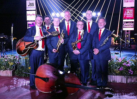 The Dutch Swing College Band pose for a group photo at the conclusion of the concert.