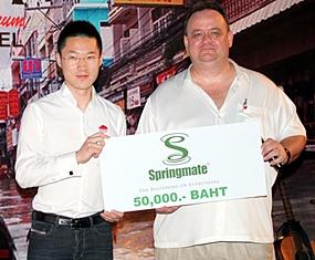 Nophol Techaphangam (Vice MD Springmate) hands a donation of 50,000 baht to Michael Procher (GM Nova Platinum Hotel, Amari Nova Suites Pattaya and Nova Gold Hotel).