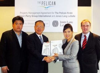 Pornchai Ngamsappasilp, Chairman of Perry Group International (center left) and Suphin Mechuchep, Managing Director of Jones Lang LaSalle (center right), exchange the property management contracts for The Pelican Krabi. Also seen in the picture are Andrew Ngamsappasilp, CEO of Perry Group International (far left) and Dexter Norville (far right), Head of Estate Management of Jones Lang LaSalle.