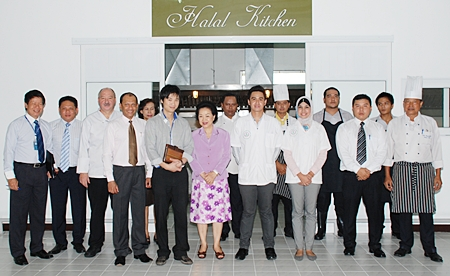 Executives of the Royal Cliff Hotels Group, led by the managing director, Panga Vathanakul (7th left), pose in front of the Halal Kitchen on receiving the Hygiene-Assurance-Liability Quality (HAL-Q) certification from the Halal Science Centre, Chulalongkorn University recently. Representing the university are Anat Denyingyhot (4th right) and Kobkarn Namsirilert (3rd right).