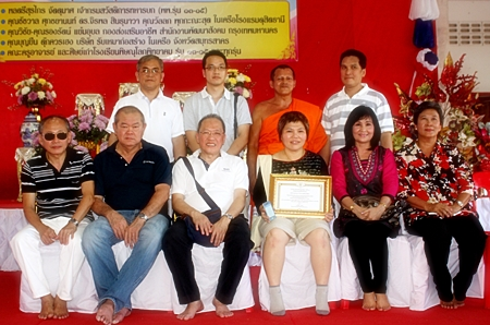As part of the hotel's Community Service Responsibilities (CSR) initiatives, Chatchawal Supachayanont (seated 3rd left), general manager of the Dusit Thani Pattaya, led his management team and staff on their annual 'Krathin' pilgrimage to rural areas in Thailand to donate cash, school supplies for children including computers and other necessities for schools and hospitals in the region. This year the benevolent hoteliers chose the community of Tambol Khoksalut sub-district in Phitsanulok province to bring their love and care. They were welcomed by happy villagers who invited them to pay homage in Wat Kamphaengmanee before thankfully receiving the humanitarian aid.