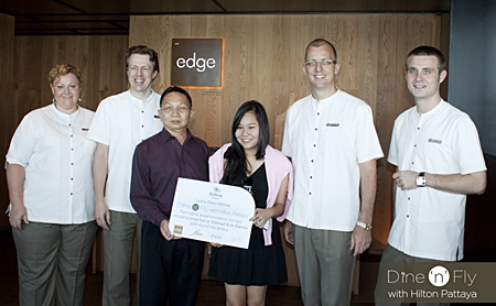 Kanthicha Pichaikamchornvud (3rd left) stands proudly with her father Wallop Pichaikamchornvud as she receives the top prize in the hotel's promotional campaign 'Dine 'n' Fly with Hilton Pattaya'. Her prize included return airfare for two, two nights' accommodation and daily breakfast at Conrad Koh Samui. On hand to witness the handover were Peta Ruiter, Director of Business Development, Michel Scheffers, Director of Operations, Harald Feurstein, General Manager, Hilton Pattaya and Simon Bender, Food & Beverage Manager.