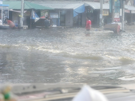 Flood waters rage in the outskirts of Bangkok.