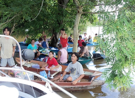 Escaping from the midday sun by rafting together under the shade of trees in flood stricken in Ayuthaya province.