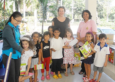 Miss Lily's children are pictured here donating money from their bake sale to the staff at Rangsit Home for Babies.