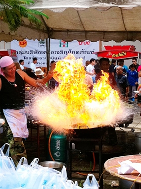 Cooking Thai food for the masses can be quite dangerous.