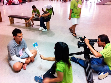 A TV interview with the president of the Student Union in the center of help.