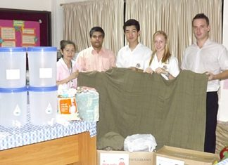 Tony Malhotra (2nd left) and Andrew Emery (right), together with students Sangjin and Jasmine from St Andrews brought life-saving water filters and Swiss International Air Lines blankets for the children.