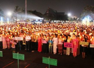 His Majesty the King's loyal subjects in Pattaya hold a candlelight ceremony at last year's grand royal birthday celebration held at Bali Hai Pier.