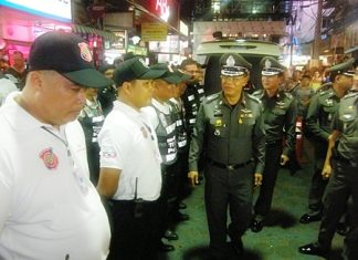 Acting Region 2 police chief Lt. Gen. Punya Mamen walks the entire length of Walking Street, shaking hands, posing for photographs and thanking officers for ensuring safety.