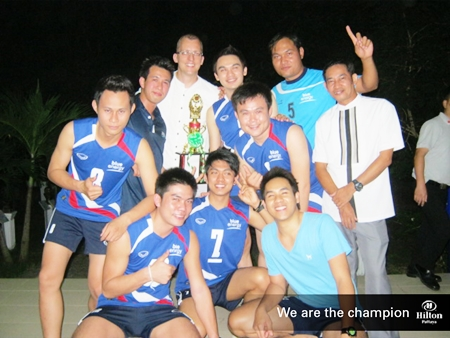 Harald Feurstein, General Manager of Hilton Pattaya (standing 3rd left) poses for a photo with the victorious Hilton Pattaya male volleyball team.