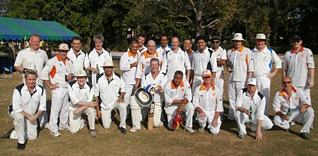 PCC Thoroughbreds and British Club cricketers pose for a photo at Horseshoe Point, Sunday, November 20.