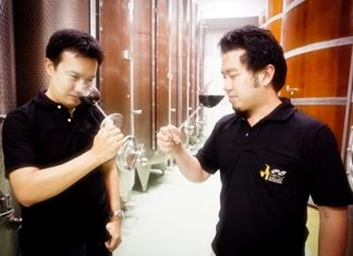 Prayut Piangbunta (left), Director of Khao Yai Winery & Chief Winemaker with Joolpeera Saitrakul, Assistant Winemaker, putting their noses to work.