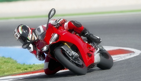 Knee down on the Ducati.