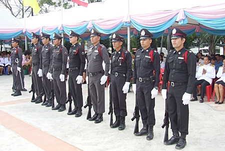 Police prepare to fire a 21 gun salute.