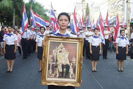 Navy cadets from the Raja Navy Commercial School carry a revered photo of HM the King in the annual parade down Pattaya Beach Road.