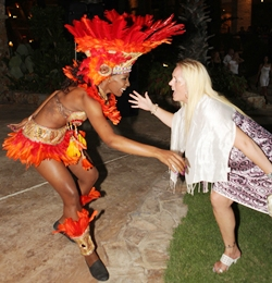 One of the guests starts shaking her body along with one of the colorful Brazilian Zico's dancing girls.