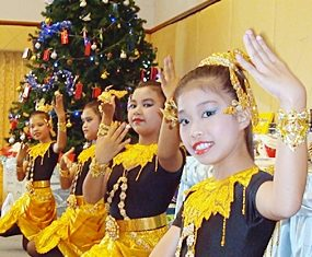 Pattaya Orphanage dancers perform traditional Thai dances.
