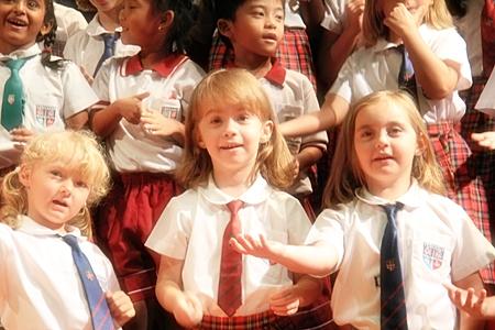 Key Stage 1 Choir performing beautiful Christmas carols.