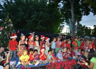 """The children happily entertain their parents with """"Jingle Bells Rock!"""""""