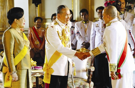 His Majesty the King is congratulated by Cambodian King Norodom Sihamoni as HM Queen Sirikit, looks on at the Ananda Samakhom Throne Hall in Bangkok Monday, June 12, 2006.