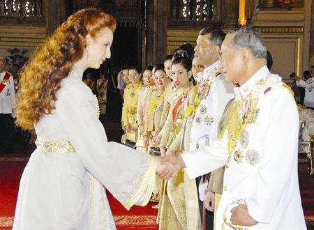 His Majesty the King is congratulated by Moroccan Princess Lalla Salma at the Ananda Samakhom Throne Hall in Bangkok Monday, June 12, 2006.