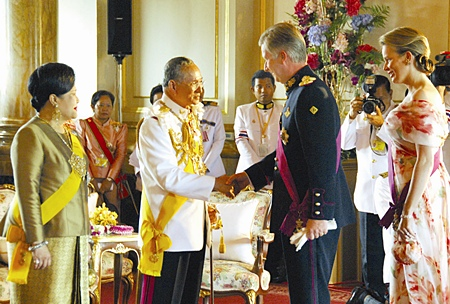 His Majesty the King is congratulated by Belgian Crown Prince Philippe and Crown Princess Mathilde,  as HM Queen Sirikit looks on at the Ananda Samakhom Throne Hall in Bangkok Monday, June 12, 2006.