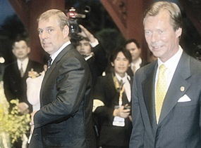 Britain's Prince Andrew, left, walks with Luxembourg Grand Duke Henri as they arrive for ceremonies Monday, June 12, 2006, at the Thai Navy headquarters in Bangkok.
