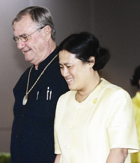 HRH Princess Maha Chakri Sirindhorn walks with Denmark's Prince Henrik as he arrived at Bangkok International Airport, Sunday, June 11, 2006.