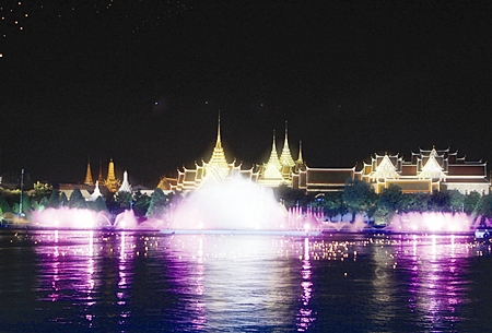 The Grand Palace forms a stunning backdrop as illuminated fountains and floating lanterns mark the passing of the Royal Barge Procession dutring the 60th anniversary celebrations of His Majesty the King's ascension to the throne in Bangkok Monday, June 12, 2006.
