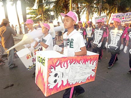 Students from local schools are being taught early, and show their knowledge with homemade signs, props and costumes.