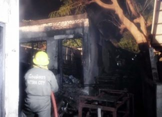 Firefighters put out the remaining embers in a hotel storage room fire that caused approximately 300,000 baht in damage.