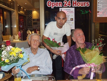 Archie Dunlop (left) and Dennis Dewsnap (right) receive flowers for their permanent help with donations.
