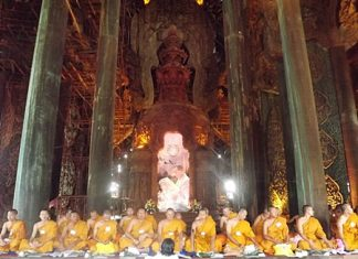 More than 100 monks gather at the Sanctuary of Truth for a religious ceremony to celebrate HM the King's birthday.