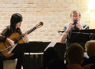 "Xuefei Yang (left) and Richard Harvey play the haunting ""Parting at Yuang Guan""."