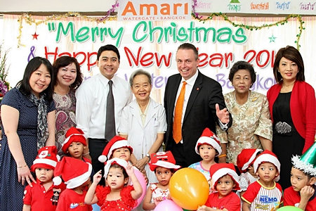 Yutthachai Charanachitta (3rd left), president & CEO of Amari Estates Co., Ltd., together with Pierre Andre Pelletier (3rd right), GM of Amari Watergate Bangkok and the hotel's management team recently celebrated a Christmas & Happy New Year party with orphans at the Thai Red Cross Children's Home. The kind hearted hoteliers hosted lunch and brought lots of presents for the kids. Others in the team included Wanna Charoenchaimongkol, director of finance, Chatrapee Kantariyo, executive assistant manager, Assoc. Professor Khunying Saree Chittinand, member of the board of trustees, Surat Kajittanon, head of Home Office and Nichaya Chaivisuth, director of communications & PR.