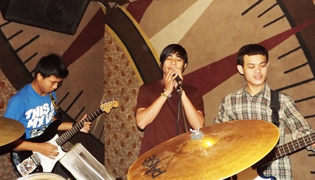 Wuthisak (right) plays with friends in the Teamshow band.