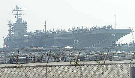 USS Abraham Lincoln aircraft carrier tied up at Laem Chabang Port.
