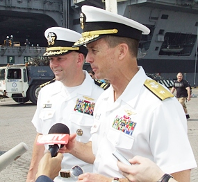 Captain John D. Alexander (left), Commanding Officer USS Abraham Lincoln (CVN 72), and Troy M. Shoemaker (right), Commander of Aircraft Carrier 9, give an interview to the media.