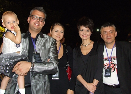 Celebrations for the whole family. (l-r) Andrey Snetkov, marketing and contracting director, TEZTOUR holding his daughter Polina, Natalia Panova, director of Finance, TEZTOUR , Elena Iljina, director of sales and marketing, Ilves Tour and Michel Iljin, group general manager, Ilves tour.