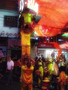 Chinese acrobats thrill the crowds on Walking Street.
