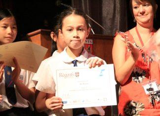 Competition winner Bel Walton receiving her certificate.