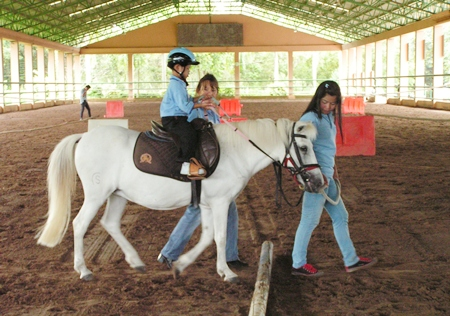 A.D.F. Thailand is a foundation that provides therapy riding for disabled children.