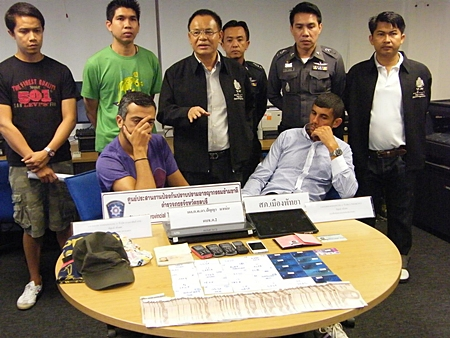 Hassainia and Raihane face the press after being caught using counterfeit credit cards to steal from Thai ATMs.