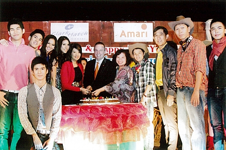 Pierre Andre Pelletier (centre), GM of the Amari Watergate Bangkok joined by many celebrities cuts the cake during the Xmas & New Year Cowboy Night Party organized by Clark Hatch Fitness Center.