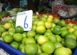 An after effect of last year's major flooding has been increased inflation, including limes such as these at the Naklua market.