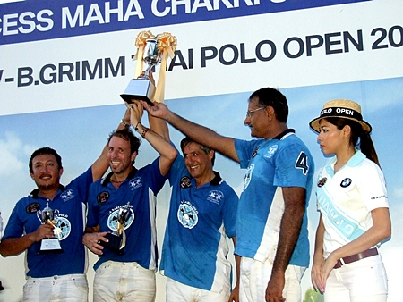Tournament winners La Sarita raise the Princess Cup trophy after winning the 2012 BMW-B.Grimm Thai Polo Open final.