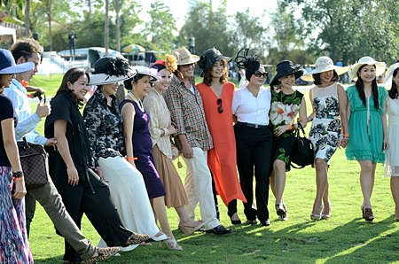 Stopping the divots is a tradition at any polo event.