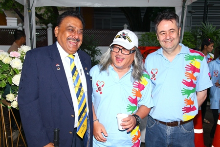 Past President Wanit Mekdhanasarn, brainchild of the Coins on Silom many years ago, is flanked by Past District Governor Peter Malhotra (left) and Mark Butters, president of the Rotary Club of Bangkok South.